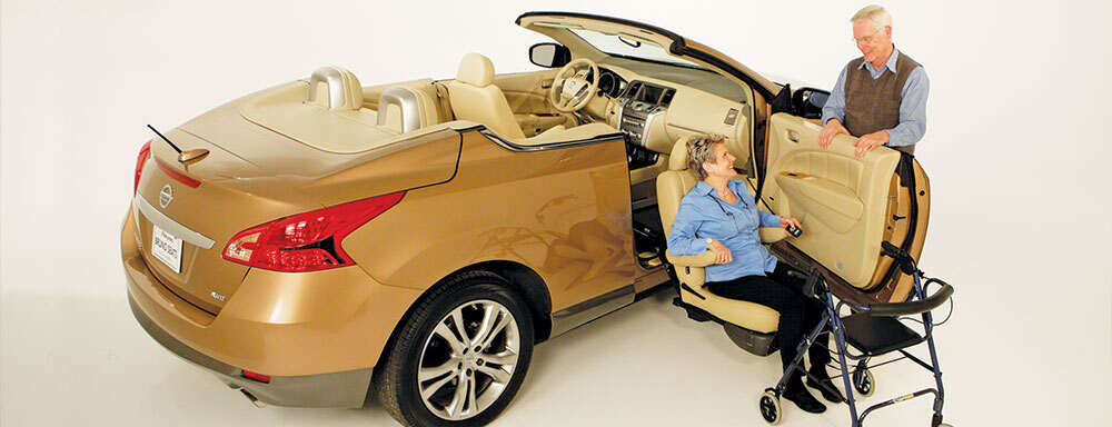 gold-nissan-convertible-with-woman-in-front-passenger-side-seat-using-transfer-seat-base