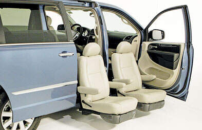 blue-van-displaying-factory-seats-in-front-and-rear-passenger-side-installed-on-top-of-transfer-seat-base