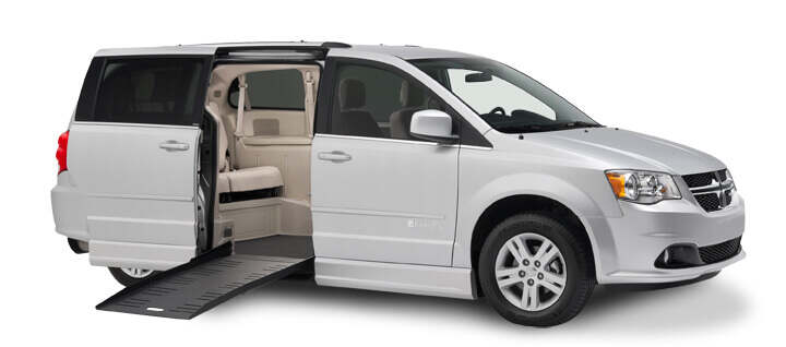 Silver Dodge CompanionVan side entry with ramp extended