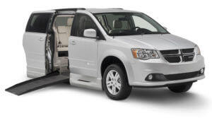 Smaller image of side entry gray Dodge caravan with Braunability logo on the passenger side door