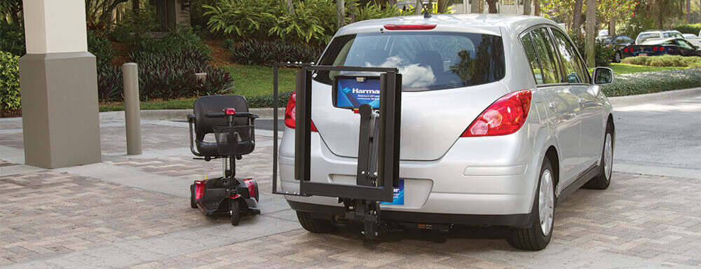 exterior scooter lift on back of silver vehicle