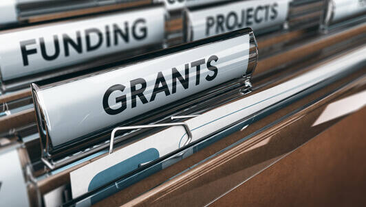filing folders showing grants and funding tabs