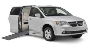 Small image of gray Dodge wheelchair van with slightly elevated ramp and braunability logo on passenger side door