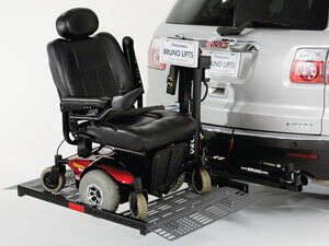 power wheelchair lift on back of silver vehicle