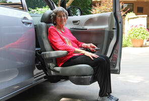 woman getting out of vehicle using a turning seat