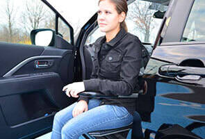 woman using an Adapt xl board to exit a vehicle